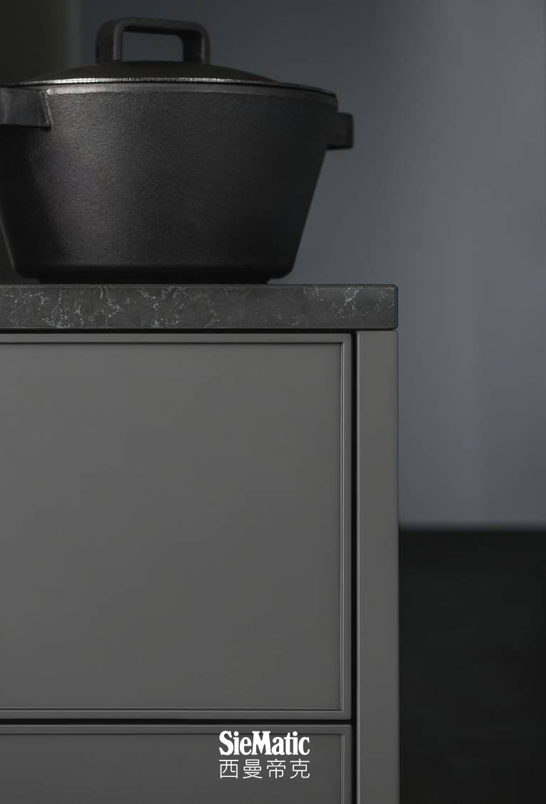 SieMatic Pure SE 3003 R base cabinet and side panels in umbra matte lacquer with composite stone countertop