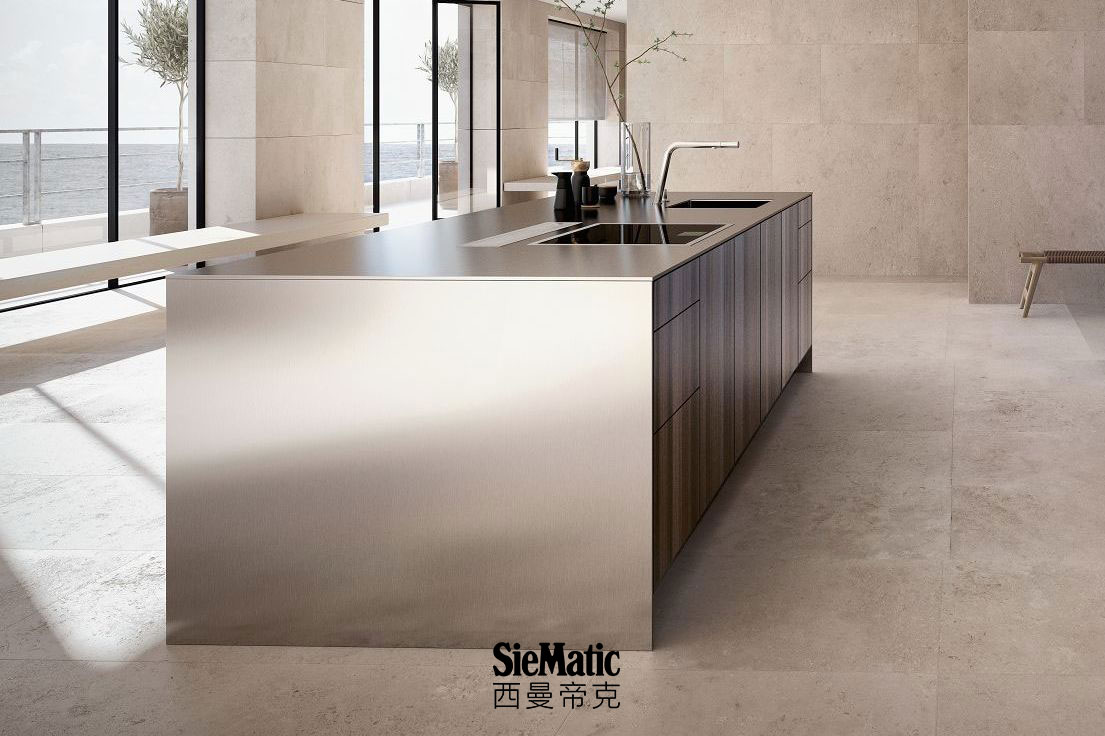 SieMatic Pure SE kitchen island in smoked oak veneer with countertop and side panels that appear 1 cm thick in stainless steel