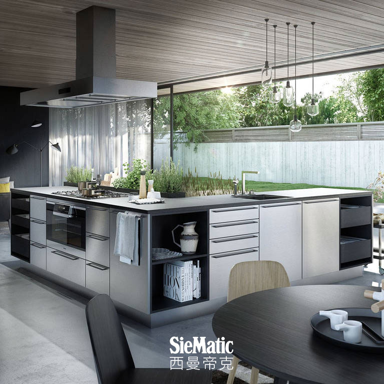 SieMatic Urban SE kitchen island in graphite oak and stainless steel with herb garden and StoneDesign countertop in granite