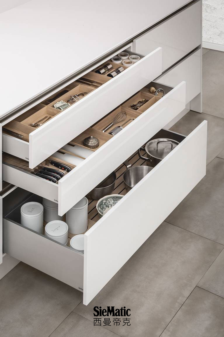 SieMatic kitchen interior accessories for drawers and pull-outs offer versatile organization options.