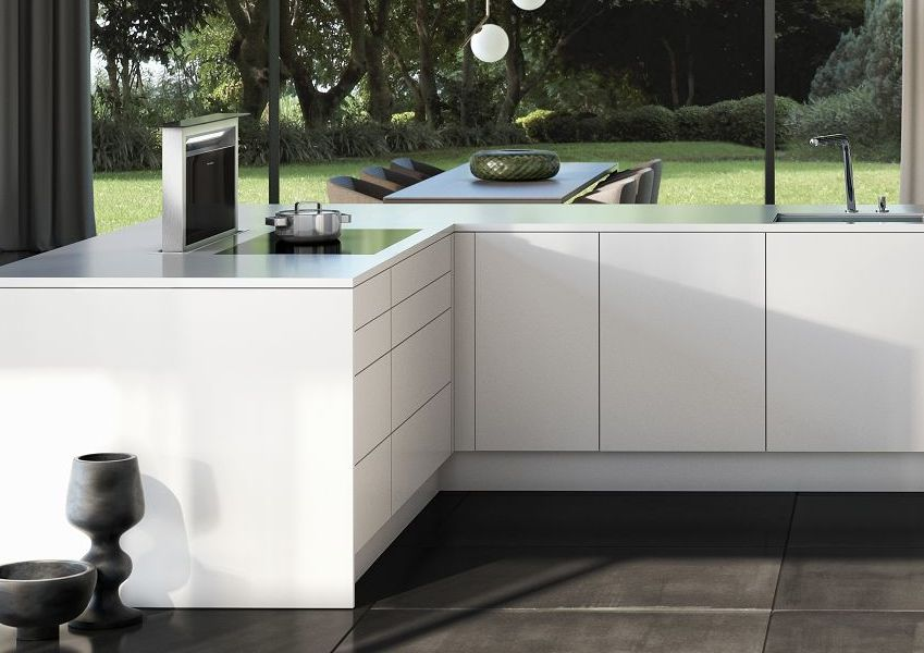 SieMatic Pure SE base cabinets in glossy lotus white SQ lacquer with downdraft extractor
