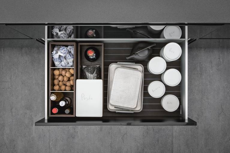 Porcelain jars and organization inserts from SieMatic Aluminum Interior Accessories System