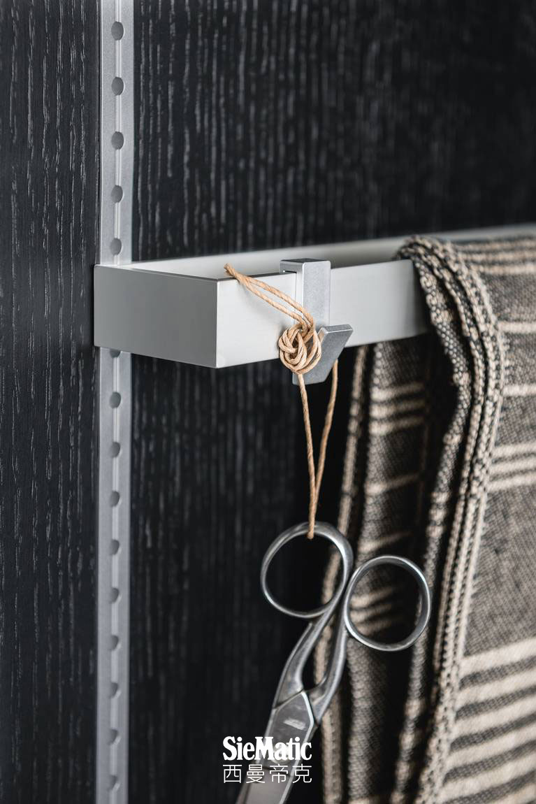 Dishcloth rack and hooks from the SieMatic MultiMatic interior organization system for kitchen cabinet doors