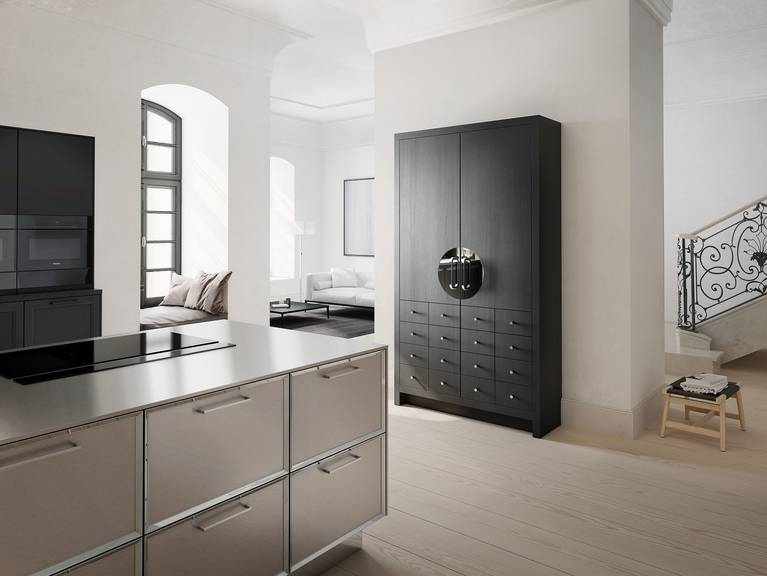 Chinese wedding cabinet from the SieMatic Classic style collection in black matte oak with polished nickel