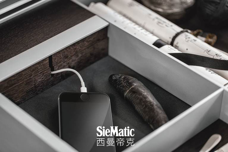 iPhone in integrated USB charging station in kitchen drawer by SieMatic