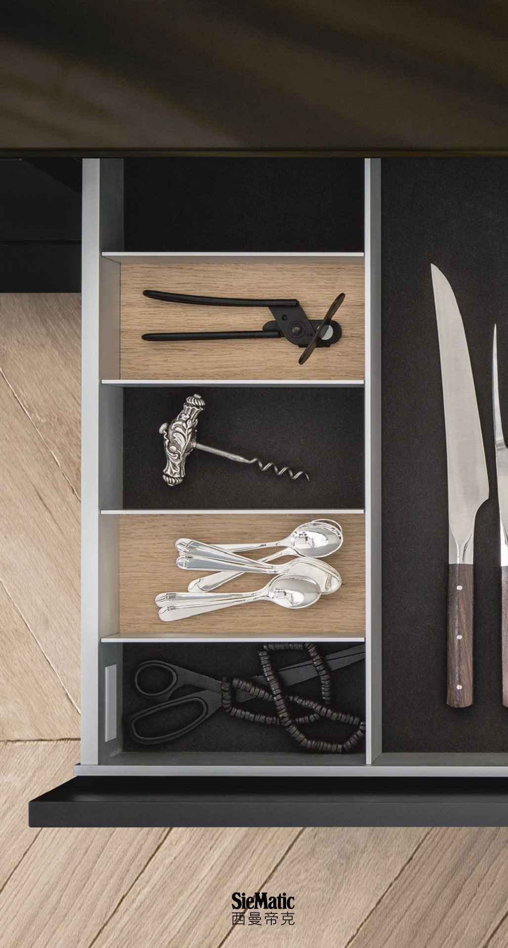 Cutlery and other functional inserts from the SieMatic Aluminum Interior Accessories System